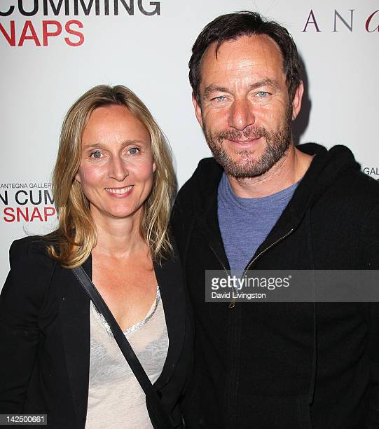 "Documentary filmmaker Emma Hewitt and actor Jason Issacs attend a private reception for the ""Alan Cumming Snaps"" exhibit featuring limited edition..."