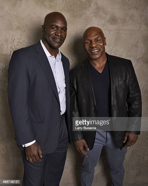 Documentary subjects Evander Holyfield and Mike Tyson from Champs during the 2014 Tribeca Film Festival at the Monarch Room on April 19 2014 in New...