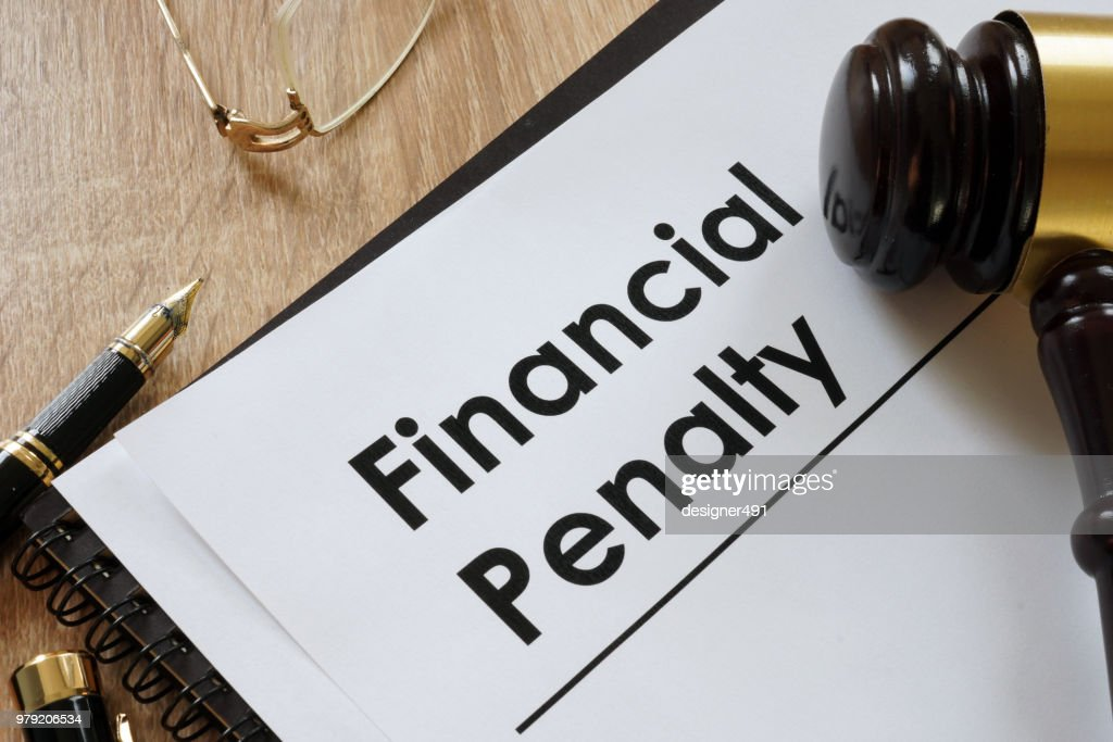 Documents about Financial penalty and gavel in the court. : Stock Photo