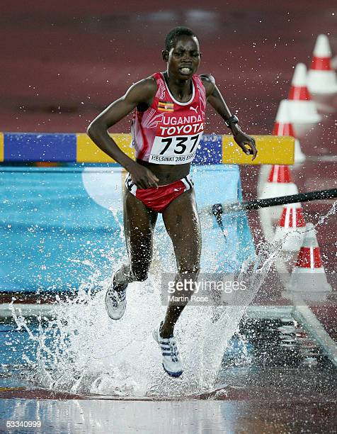 Docus Inzikuru of Uganda competes in the women's 3000 metres Steeplechase final at the 10th IAAF World Athletics Championships on August 8, 2005 in...