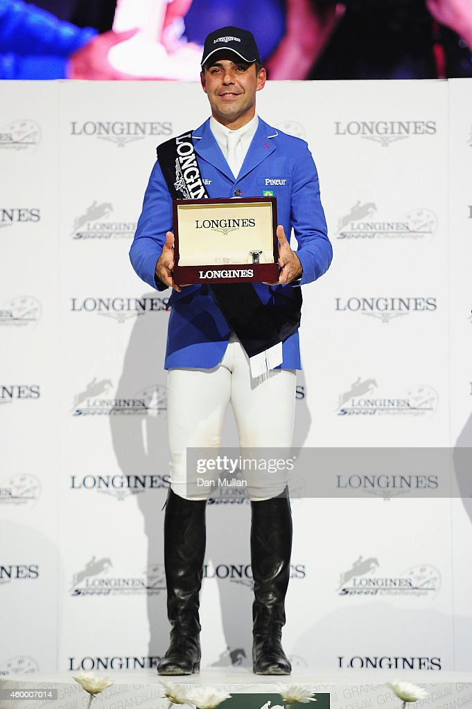 Doda de Miranda from Brazil celebrates his 1st place finish at prize ceremony of the Longines Speed Challenge Prix class as part of the Gucci Paris Masters 2014 on December 5, 2014 in Villepinte, France.