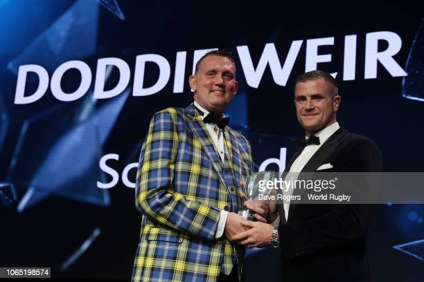 Doddie Weir receives the Award for Character in association with Land Rover from Jamie Heaslip of Ireland during the World Rugby via Getty Images...