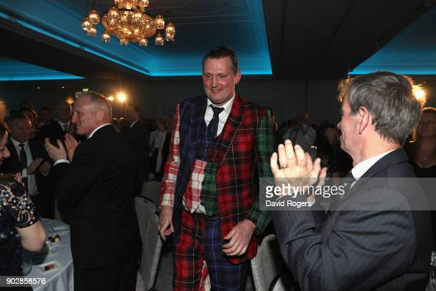 Doddie Weir the former Scotland international and Newcastle Falcons player walks onto the stage during the Rugby Union Writers' Club Annual Dinner...