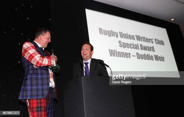 Doddie Weir the former Scotland international and Newcastle Falcons player talks with Alastair Eykyn the RUWC master of ceremonies during the Rugby...