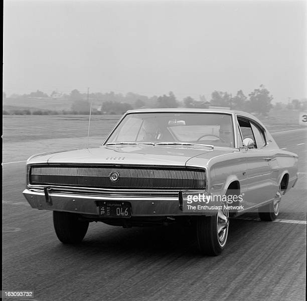 Dodge Charger was the cover car on Motor Trend magazine's January 1966 issue Dodge is on the march with a sleek fourpassenger fastback a basket of...