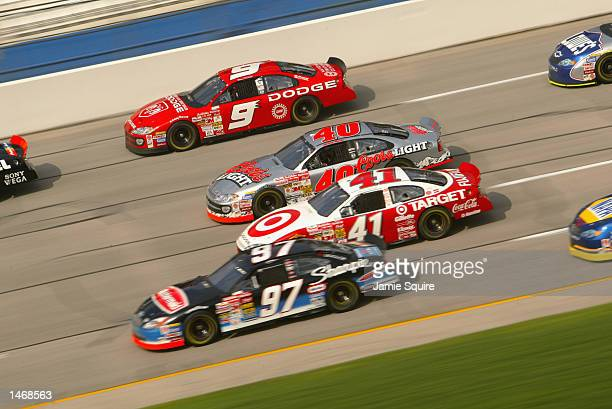 Dodge Intrepid R/T drivers Bill Elliott Jamie McMurray and Jimmy Spencer practice alongside Kurt Busch during practice for the EA Sports 500 at...