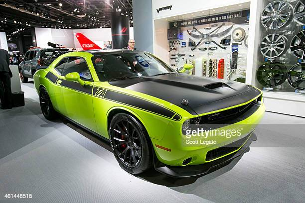 Dodge reveals the new RT HEMI Challenger to the media at the 2015 North American International Auto Show at Cobo Center on January 12 2015 in Detroit...