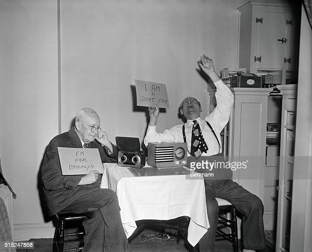 Dodger fan Frank Lavelle sits dejectedly as he listens to a DodgersPhillies game on his radio in the apartment of his friend and Giant fan 73yearold...