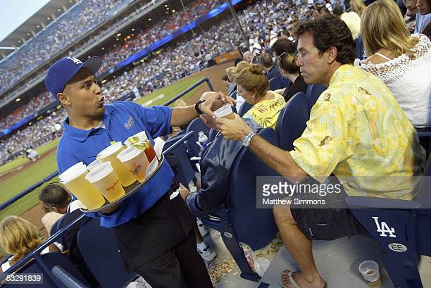 Dodger fan Pat Theodora buys a beer in The Dugout Club at Dodger Stadium on July 26 2005 in Los Angeles California