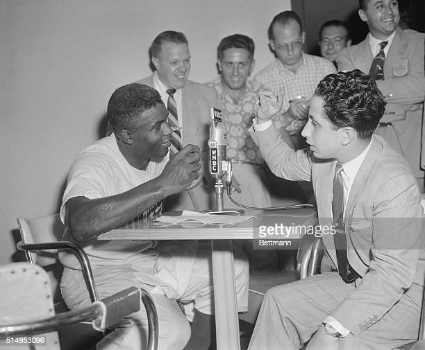 Dodger second baseman Jackie Robinson chats with Iraq's King Faisal in the press room at Ebbets Field following the game with the New York Giants...