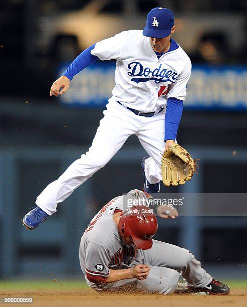 Dodger second baseman Mark Ellis avoids Diamondback base runner Miguel Montero after completing a double play in the 2nd inning at Dodger Stadium...
