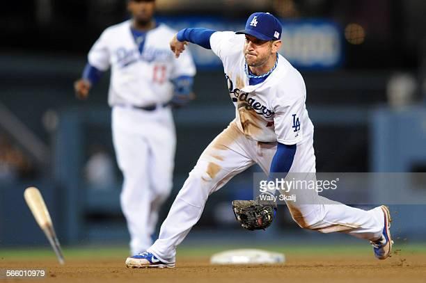 Dodger second baseman Nick Punto fields the ball from Diamondback hitter Gerardo Parra and avoids a broken bat in the 6th inning at Dodger Stadium...