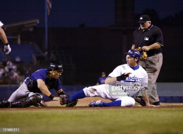 Dodger Shawn Green is safe at home under Rockies Bobby Estallela's tag in the fourth inning.