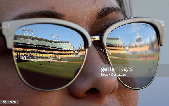 3cf02776c99 Dodger Stadium is reflected in the sunglasses of a fan during batting...  News Photo