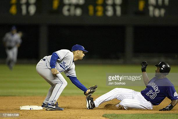 Dodgers Alex Cora tags out Rockie Charles Johnson in the 7th at Coors Field