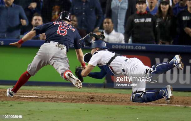 Dodgers Austin Barnes tags out Red Sox Ian Kindler at home plate in the tenth inning Los Angeles Dodgers hosted the Boston Red Sox in Game 3 of the...