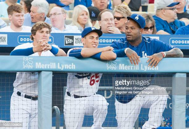 Dodgers backup catcher Austin Barnes, center, a former Riverside Poly standout, chats with Kike Hernandez, left, and Carl Crawford during the Dodgers...