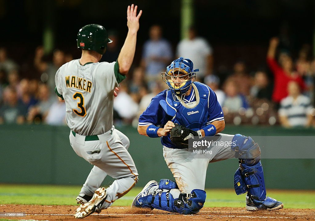 Dodgers catcher A. J. Ellis makes the play to prevent Mike Walker of Australia from scoring during the match between Team Australia and the LA Dodgers at Sydney Cricket Ground on March 20, 2014 in Sydney, Australia.