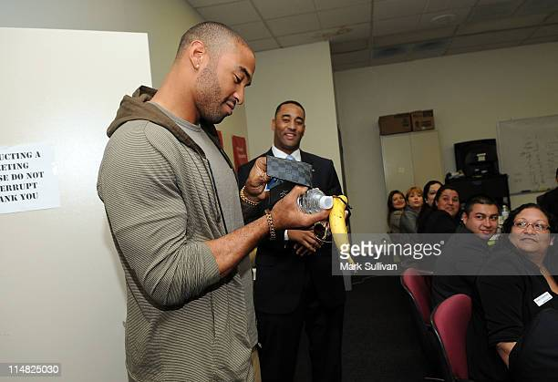 Dodgers Center Fielder Matt Kemp and Bank of America Regional Consumer Executive Barry Simmons surprise employees meeting during his unannounced...