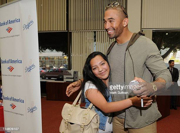 Dodgers Center Fielder Matt Kemp greets customer Shanice Dzul during one of his surprise appearances at Bank of America banking centers in Hollywood...