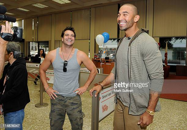 Dodgers Center Fielder Matt Kemp suprises customer Craig DiFrancia during one of his unannounced appearances at Bank of America banking centers in...