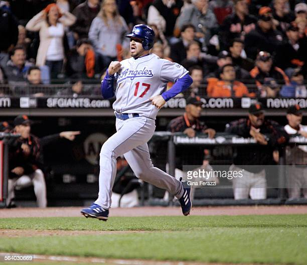 Dodgers Jason Repko races to home plate to score the go–ahead run in the ninth inning on a wild pitch against the San Francisco Giants AT&T Park in...