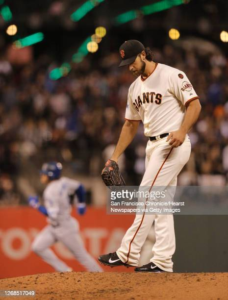 Dodgers' Kike Hernandez rounds the bases after hitting a solo home run in the second inning off starting pitcher Madison Bumgarner, as the San...