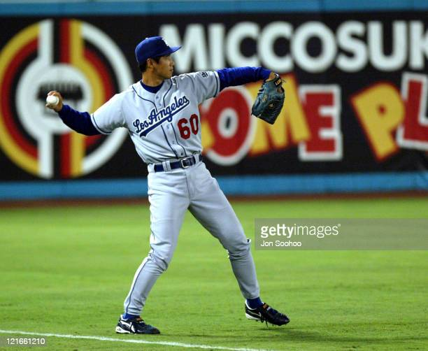 Dodgers' Maseo Kida warms up left fielder in the 8th inning at Pro Player Stadium Marlins won 21