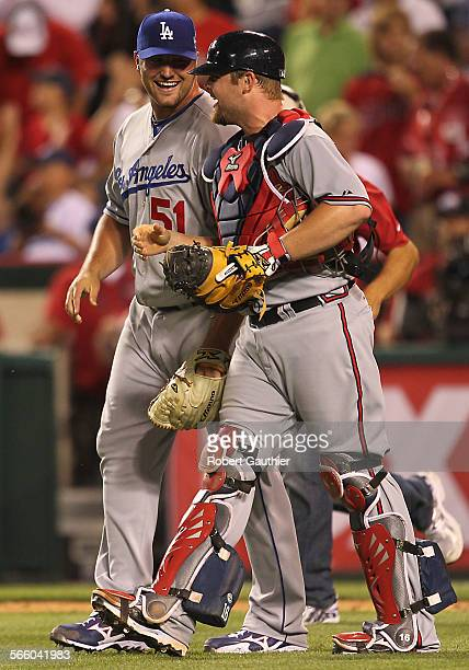Dodgers pitcher Jonathan Broxton and catcher Brian McCann celebrate a 3–1 win for the National League at the Major League Baseball 2010 All Star game...