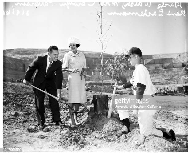 Dodgers plant first tree in Chavez Ravine, 9 March 1961. Ash tree planted ;Dick Walsh ;Mrs Carolyn Patterson ;Rene Lachemann .;Caption slip reads:...