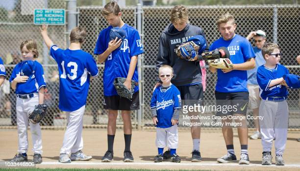 Dodgers players and buddies line up for the National Anthem before the 19th Annual Challenger Division Closing Day Games begin. ///ADDITIONAL...