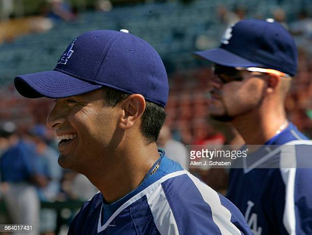 Dodgers players Oscar Robles left and Ramon Martinez right are competing for the utility infielder position as they practice at spring training...