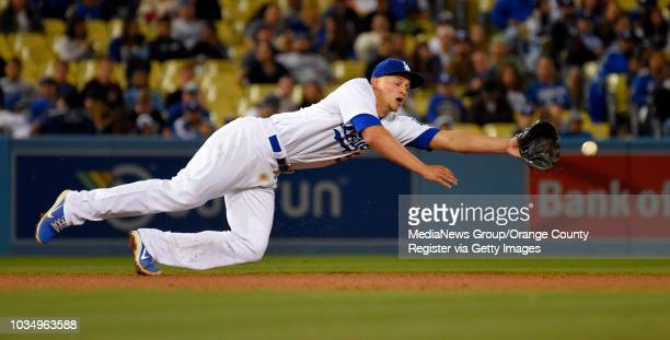 Dodgers SS Corey Seager is unable to stop a hit by AJ Pollock in Los Angeles CA on Monday April 17 2017 Dodgers lost to the Diamondbacks 42