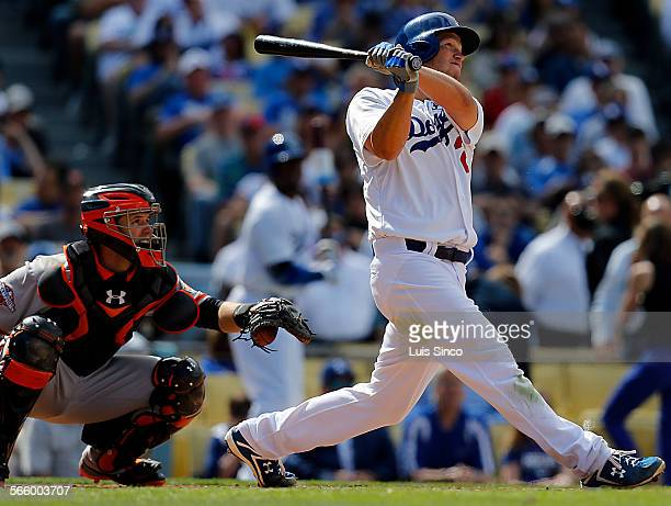 Dodgers starting pitcher Clayton Kershaw tracks the trajectory of his solo home run in the eighth inning of the season opener against the San...
