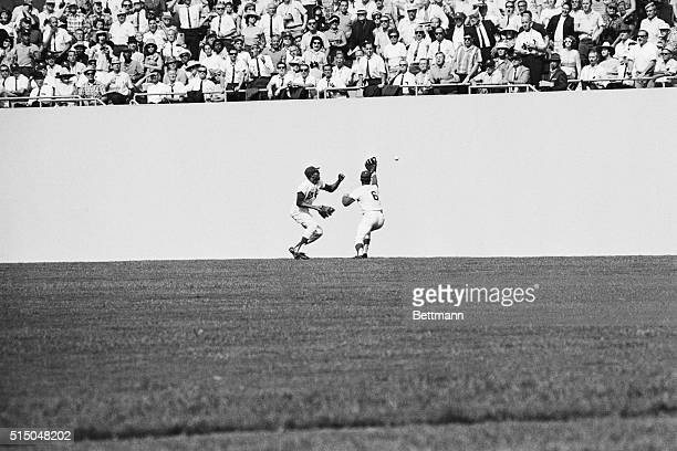 Dodgers' Willie Davis and Ron Fairly both miss catching a ball hit to rightcenter by Baltimore Orioles' Frank Robinson in the sixth inning of the...