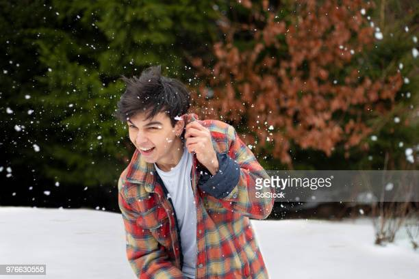 dodging the snowball - ducking stock pictures, royalty-free photos & images