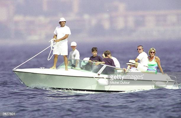 Dodi al Fayed Prince Harry and Diana Princess Of Wales are seen in St Tropez in the summer of 1997 shortly before Diana and boyfriend Dodi were...