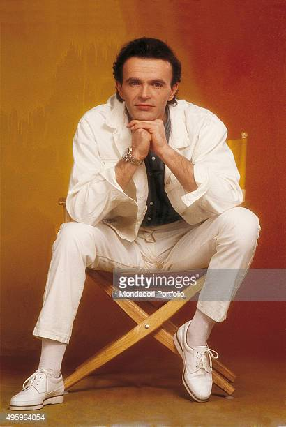Dodi Battaglia guitarist and singer of the Italian band Pooh posing sitting on a chair Photo shoot Italy 1985