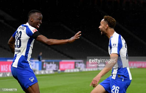 Dodi Lukébakio of Hertha Berlin celebrate with team mate Matheus Santos Carneiro Da Cunha after he scores the 2nd goal during the Bundesliga match...