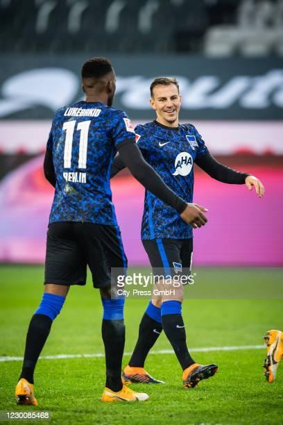 Dodi Lukebakio and Vladimir Darida of Hertha BSC celebrate after scoring the 0:1 during the Bundesliga match between Borussia Moenchengladbach and...