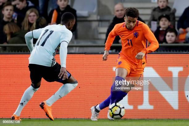 Dodi Lukebakio Ngandoli of Belgium U21 Arnaut Groeneveld of Holland U21 during the match between Holland U21 v Belgium U21 at the De Vijverberg on...