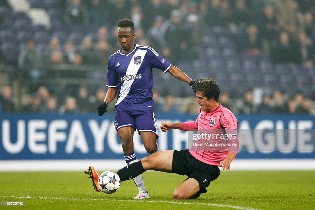 Dodi Lukebakio of Anderlecht and Jorge of Porto battle for the ball during the UEFA Youth League quarter final match between RSC Anderlecht and FC Porto at Constant Vanden Stock Stadium on March 18, 2015 in Brussels, Belgium.