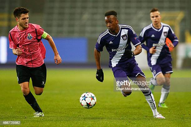 Dodi Lukebakio of Anderlecht and Rui Moreira of Porto battle for the ball during the UEFA Youth League quarter final match between RSC Anderlecht and...