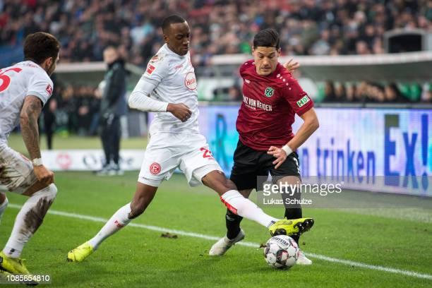 Dodi Lukebakio of Düsseldorf challenges for the ball with Miiko Albornoz of Hannover during the Bundesliga match between Hannover 96 and Fortuna...