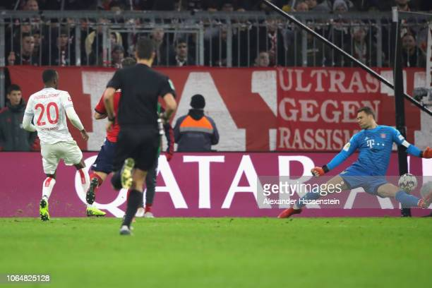 Dodi Lukebakio of Duesseldorf scores the 2nd team goal against Manuel Neuer of Bayern Muenchen during the Bundesliga match between FC Bayern Muenchen...