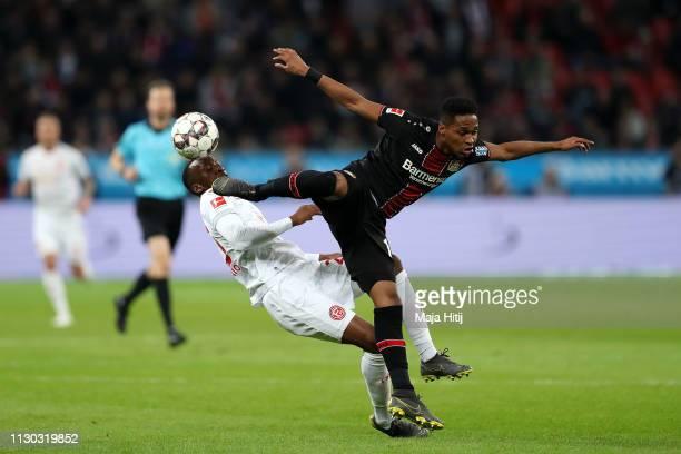 Dodi Lukebakio of Fortuna Duesseldorf is challenged by Wendell of Bayer 04 Leverkusen during the Bundesliga match between Bayer 04 Leverkusen and...