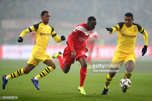 Dodi Lukebakio of Fortuna Duesseldorf runs with the ball under pressure from Abdou Diallo of Borussia Dortmund and Manuel Akanji of Borussia Dortmund...