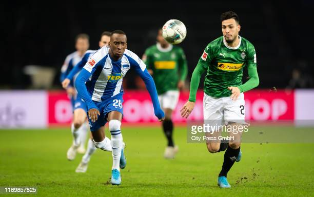 Dodi Lukebakio of Hertha BSC and Ramy Bensebaini of Borussia Moenchengladbach compete for the ball during the Bundesliga match between Hertha BSC and...