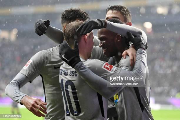 Dodi Lukebakio of Hertha BSC celebrates after he scores his sides first goal during the Bundesliga match between Eintracht Frankfurt and Hertha BSC...