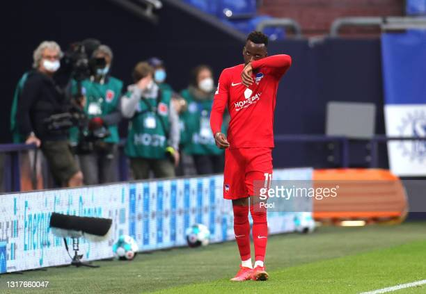 Dodi Lukebakio of Hertha BSC leaves the pitch after being shown a red card during the Bundesliga match between FC Schalke 04 and Hertha BSC at...